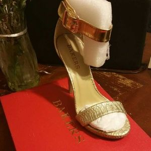 Gold heels by Bakers